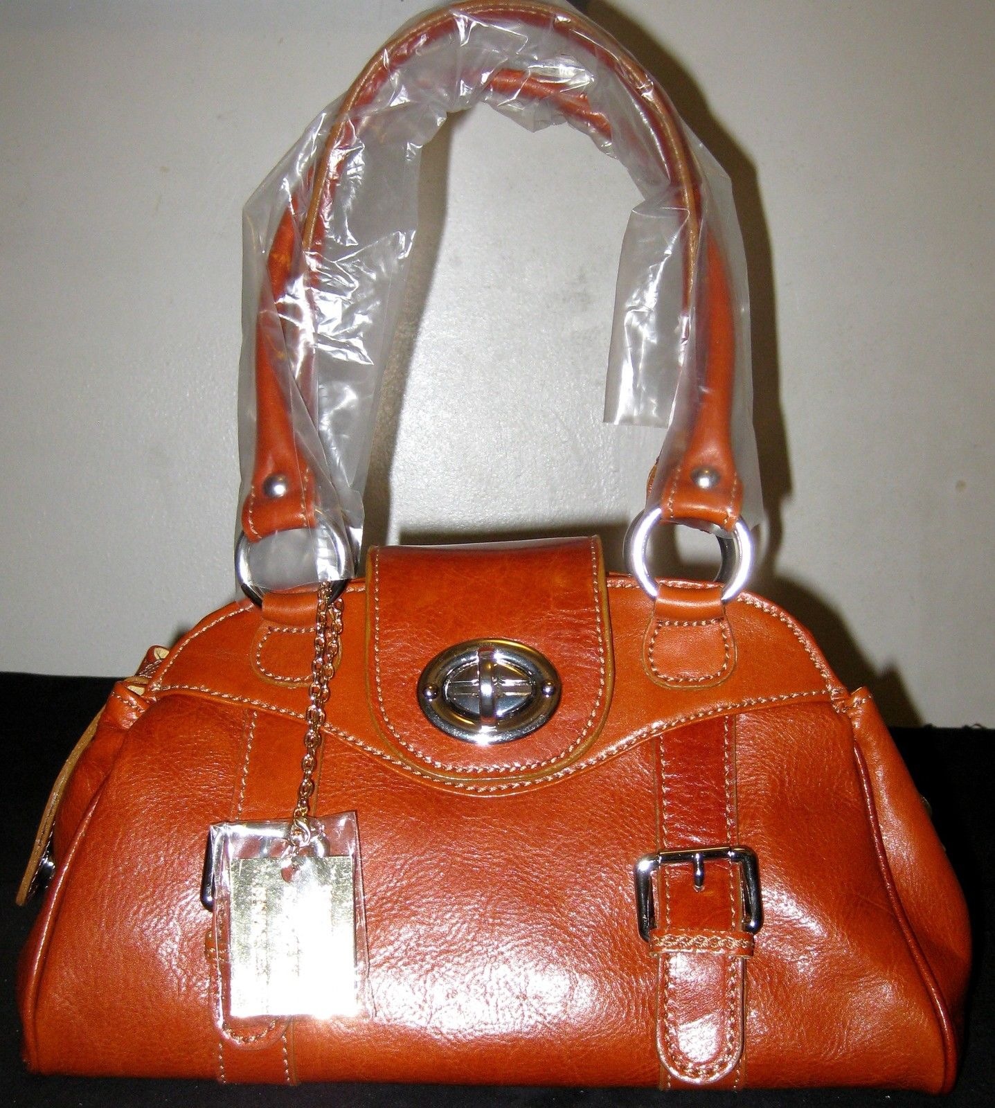 100% Italy Leather Shoulder Bags-Tower Bridge Handbags Orange Color.